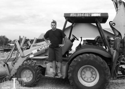 Owner Mike Cullen on tractor at a paver job